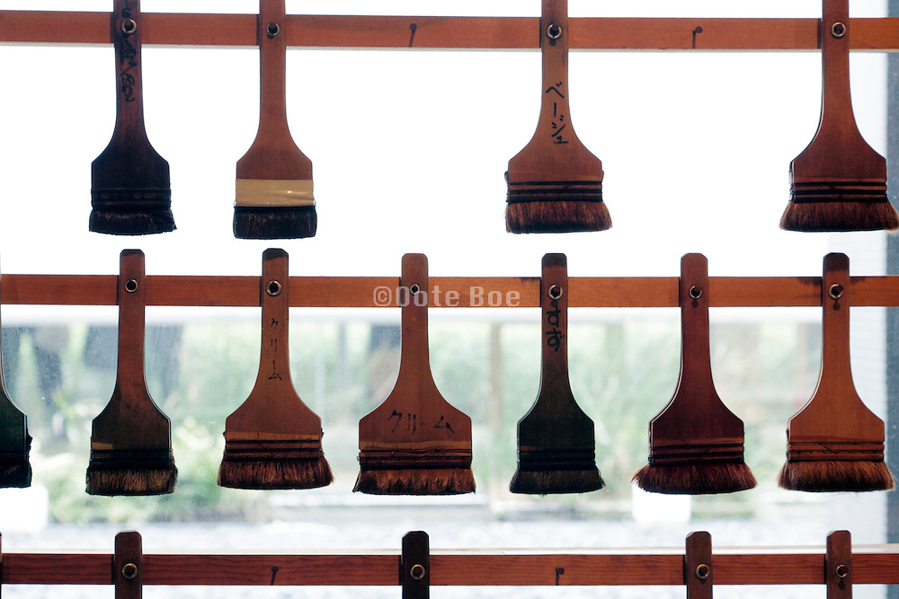 rows with paintbrushes used for dyeing fabrics
