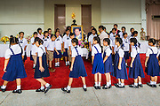 09 OCTOBER 2014 - BANGKOK, THAILAND: School children walk around a portrait of Bhumibol Adulyadej, the King of Thailand, during their visit to the hospital. The King has been hospitalized at Siriraj Hospital since Oct. 4 and underwent emergency gall bladder removal surgery Oct. 5. The King is also known as Rama IX, because he is the ninth monarch of the Chakri Dynasty. He has reigned since June 9, 1946 and is the world's longest-serving current head of state and the longest-reigning monarch in Thai history, serving for more than 68 years. He is revered by the Thai people and anytime he goes into the hospital thousands of people come to the hospital to sign get well cards.   PHOTO BY JACK KURTZ