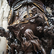 Part of the ornately carved wooden pulpit at the Cathedral of St. Michael and St. Gudula (in French, Co-Cathédrale collégiale des Ss-Michel et Gudule). A church was founded on this site in the 11th century but the current building dates to the 13th to 15th centuries. The Roman Catholic cathedral is the venue for many state functions such as coronations, royal weddings, and state funerals. It has two patron saints, St Michael and St Gudula, both of whom are also the patron saints of Brussels.