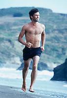 Man running on beach Marin County California USA&#xA;<br />