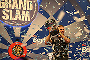 Gerwyn Price wins and holds aloft The Eric Bristow Trophy during the Grand Slam of Darts, at Aldersley Leisure Village, Wolverhampton, United Kingdom on 17 November 2019.