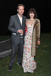 GAWAIN RAINEY and JASMINE GUINNESS at the annual Serpentine Gallery Summer Party sponsored by Burberry held at the Serpentine Gallery, Kensington Gardens, London on 28th June 2011.