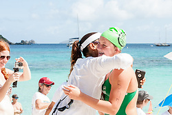 St. Croix Dolphin Natalia Kuipers, 13,  gets hugs all around as she is the first to cross the finish line at Hawksnest beach.  Friends of the Virgin Islands National Park hosts its 13th annual Beach to Beach Power Swim.  Beginning at Maho Bay racers had a choice of three distances and crossed the finish lines at Cinnamon Bay, Trunk Bay, and Hawksnest beCH.   finishiesRacers had a choice of finishing at © Aisha-Zakiya Boyd