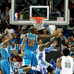 October 29, 2010; New Orleans, LA, USA; New Orleans Hornets center Emeka Okafor (50) blocks a shot by Denver Nuggets small forward Carmelo Anthony (15) during the fourth quarter at the New Orleans Arena. The Hornets defeated the Nuggets 101-95.  Mandatory Credit: Derick E. Hingle