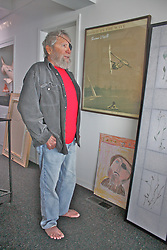 Jack O'Neill, surfer and inventor who designed the first neoprene wetsuit died at in his home on Friday June 2nd at the age of 94. Pictured here: Jack O'Neill standing with his art collection, featuring his family members, at his Pleasure Point home in Santa Cruz, 2010.