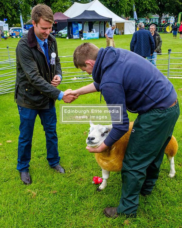 Biggar, South Lanarkshire, Scotland 23 July 2016<br /> <br /> A farmer win a champion Texel sheep in the show ring.<br /> <br /> (c) Andrew Wilson   Edinburgh Elite media