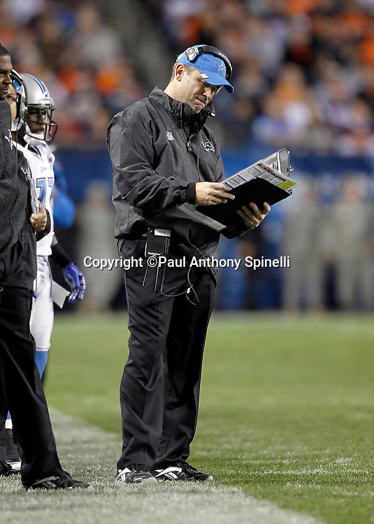 Detroit Lions offensive coordinator Scott Linehan checks out his play chart during the NFL week 10 football game against the Chicago Bears on Sunday, November 13, 2011 in Chicago, Illinois. The Bears won the game 37-13. ©Paul Anthony Spinelli