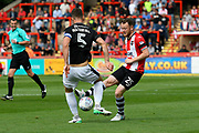 Jake Taylor (25) of Exeter City battles for possession with Luke Waterfall (5) of Lincoln City during the EFL Sky Bet League 2 match between Exeter City and Lincoln City at St James' Park, Exeter, England on 19 August 2017. Photo by Graham Hunt.