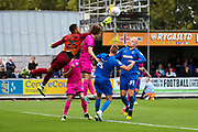 Rochdale goalkeeper Robert Sanchez (25) trying to save the ball with Rochdale defender Luke Matheson (41) pulling AFC Wimbledon attacker Marcus Forss (15) shirt during the EFL Sky Bet League 1 match between AFC Wimbledon and Rochdale at the Cherry Red Records Stadium, Kingston, England on 5 October 2019.