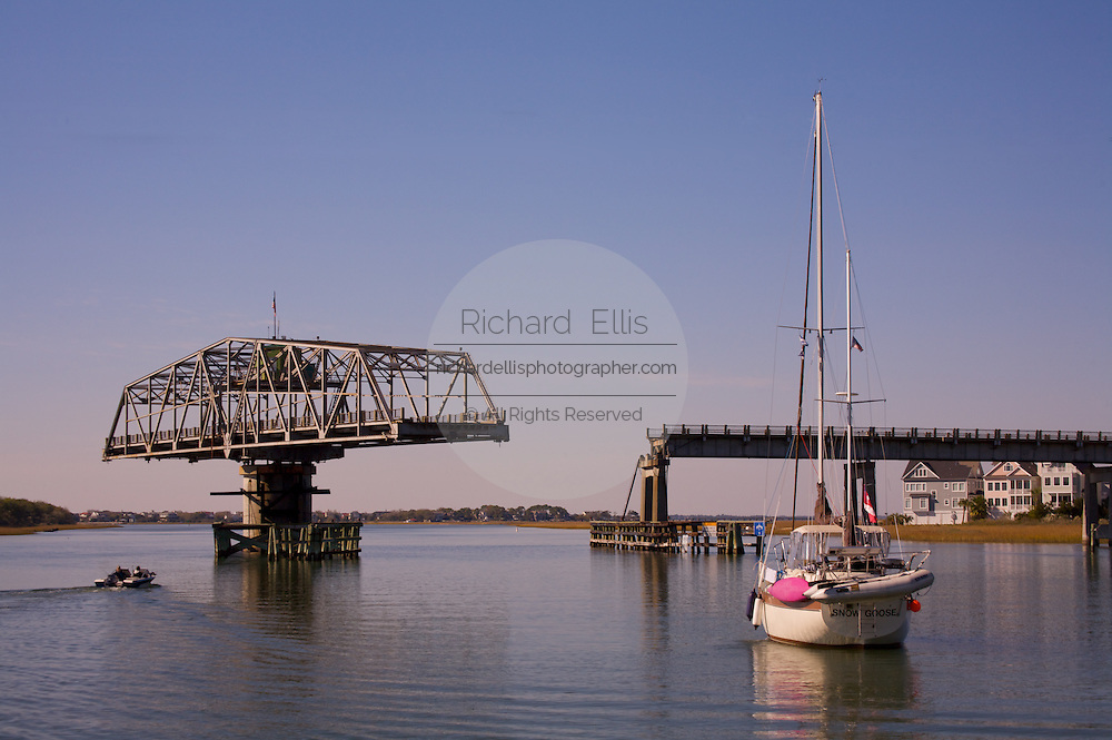 Boats pass under the Sullivan's Island, South Carolina swing bridge along the Intercoastal Waterway near Charleston.