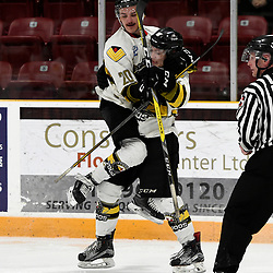 "TRENTON, ON  - MAY 3,  2017: Canadian Junior Hockey League, Central Canadian Jr. ""A"" Championship. The Dudley Hewitt Cup. Game 3 between Powassan Voodoos and the Dryden GM Ice Dogs. Parker Bowman #17 celebrates the goal with  Dayton Murray #20 of the Powassan Voodoos during the third period.<br /> (Photo by Andy Corneau / OJHL Images)"