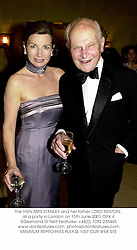 The HON.MRS STANLEY and her father LORD RENTON, at a party in London on 15th June 2001.	OPK 4