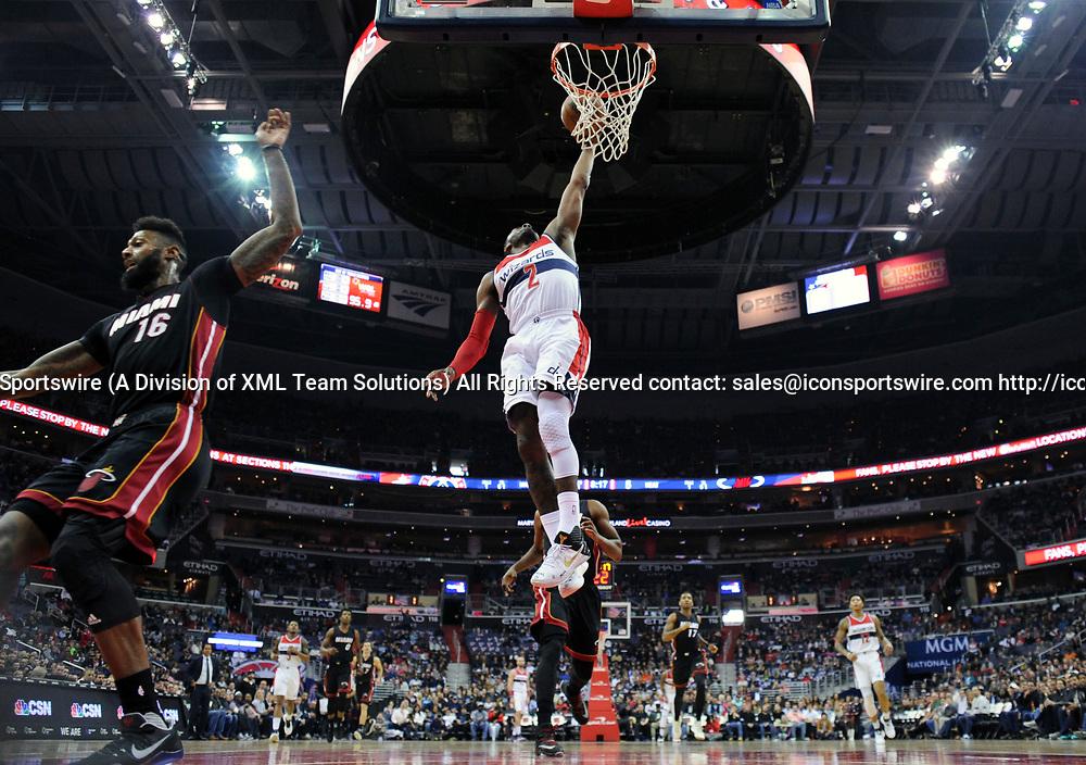 WASHINGTON, DC - APRIL 8: Washington Wizards guard John Wall (2) scores in the first half against Miami Heat forward James Johnson (16) on April 8, 2017, at the Verizon Center in Washington, D.C.  The Miami Heat defeated the Washington Wizards 106-103.  (Photo by Icon Sportswire)