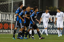 July 20, 2011; Santa Clara, CA, USA;  San Jose Earthquakes forward Chris Wondolowski (center) celebrates with teammates after scoring a goal against the Vancouver Whitecaps during the second half at Buck Shaw Stadium. San Jose tied Vancouver 2-2.