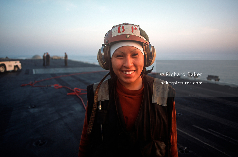 Portrait of a female US Navy crew member on the deck of US Navy aircraft carrier USS Harry S Truman during its deployment patrol of the no-fly zone at an unknown location in the Persian Gulf, on 8th May 2000, in the Persian Gulf. The Truman is the largest and newest of the US Navy's fleet of new generation carriers, a 97,000 ton floating city with a crew of 5,137, 650 are women. (Photo by Richard Baker / In Pictures via Getty Images)