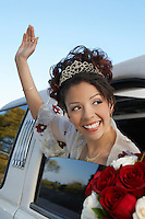 Bride waving from car window