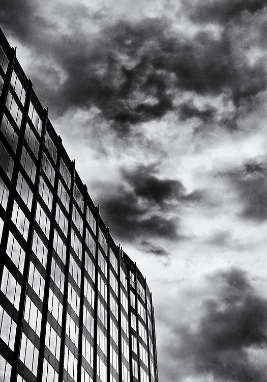 Sky and clouds reflecting into the windows of a building in downtown Charlotte, North Carolina.