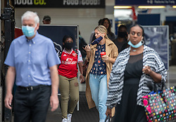 © Licensed to London News Pictures. 14/08/2020. London, UK. Commuters in face masks arrive for work in Westminster as a large police presence patrols Victoria Station this morning after the Prime Minister Boris Johnson announces that fines for not wearing a face mask on public transport and shops will rise to £3,200. Photo credit: Alex Lentati/LNP