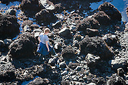 A woman explores the tidepools at Jug Handle State Natural Reserve, California