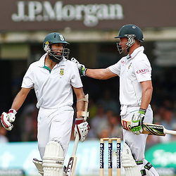 19/08/2012 London, England. South Africa's Hashim Amla gets a pat on the shoulder from South Africa's AB de Villiers after being dismissed during the third Investec cricket international test match between England and South Africa, played at the Lords Cricket Ground: Mandatory credit: Mitchell Gunn