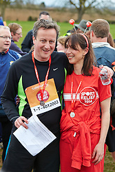 © Licensed to London News Pictures.  23/03/2014. OXFORD, UK. Prime minister DAVID CAMERON (left) and wife SAMANTHA CAMERON (right) and family at the end of the Oxford Sport Relief Mile. Photo credit: Cliff Hide/LNP