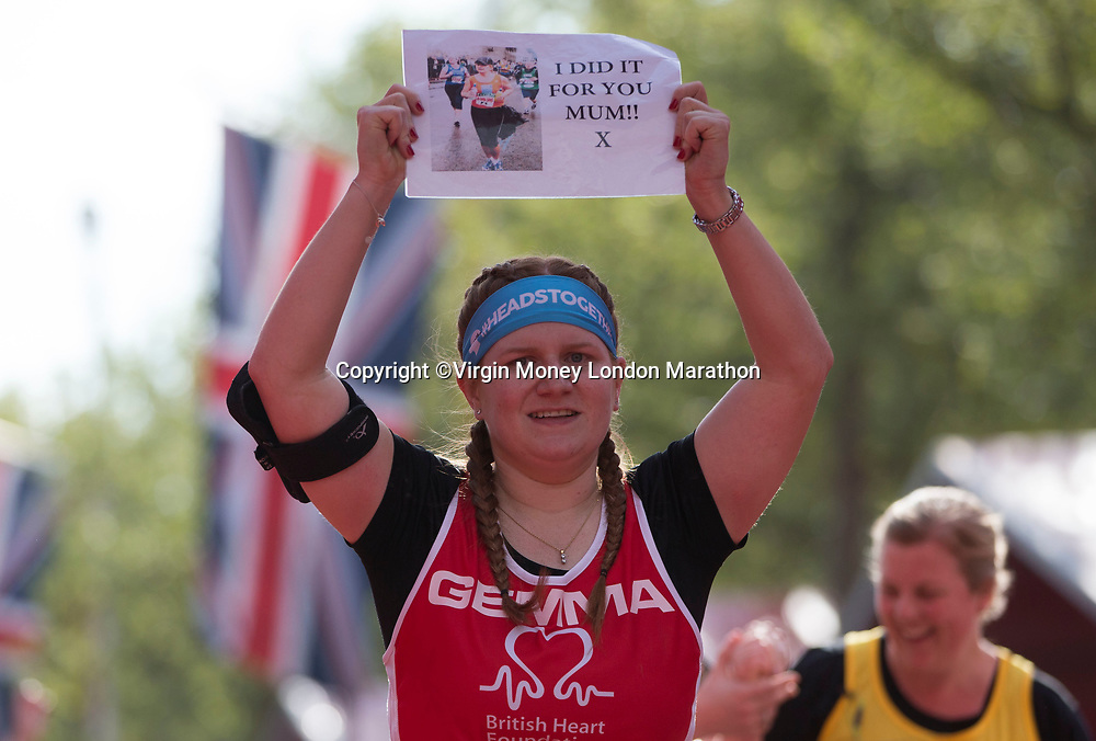 A competitor crosses the finish line. The Virgin Money London Marathon, 23rd April 2017.<br /> <br /> Photo: Jed Leicester for Virgin Money London Marathon<br /> <br /> For further information: media@londonmarathonevents.co.uk