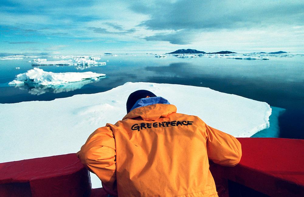 Greenpeace crewmember on MV Arctic Sunrise in sea ice in the Weddell Sea Antarctica