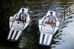 © Licensed to London News Pictures. 19/07/2016. Oxford, UK. Two young men using paddleboats while enjoying the summer sun on the River Cherwell in the grounds of Oxford University in Oxfordshire, on what is due to be the hottest day of 2016 so far, with temperatures possibly hitting the mid 30's.  Photo credit: Ben Cawthra/LNP