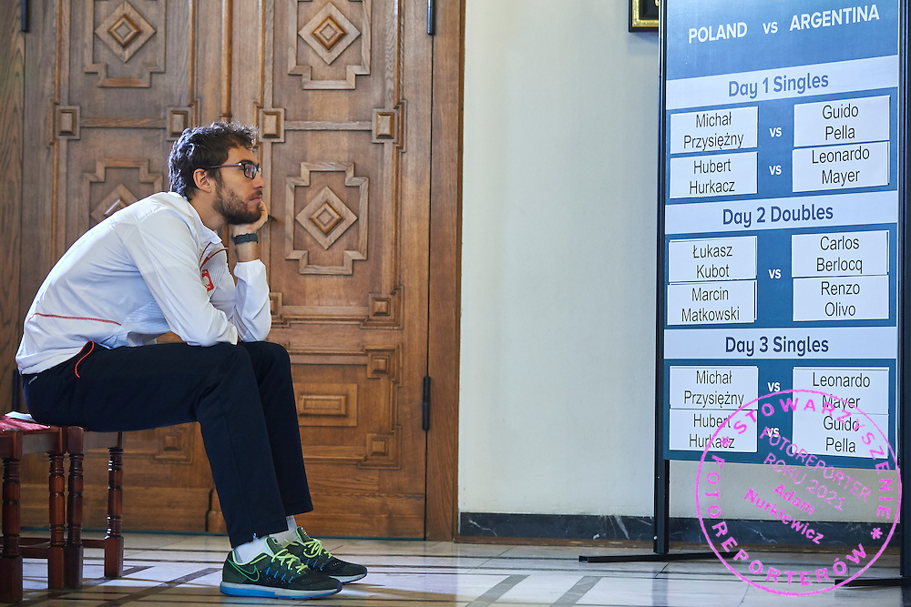 GDANSK, POLAND - 2016 MARCH 03: Jerzy Janowicz of Poland looks on ITF tia board after official draw while press conference one day before the Davies Cup / World Group 1st round tennis match between Poland and Argentina at Ergo Arena on March 3, 2016 in Gdansk, Poland<br /> <br /> Picture also available in RAW (NEF) or TIFF format on special request.<br /> <br /> Any editorial, commercial or promotional use requires written permission.<br /> <br /> Mandatory credit:<br /> Photo by &copy; Adam Nurkiewicz / Mediasport