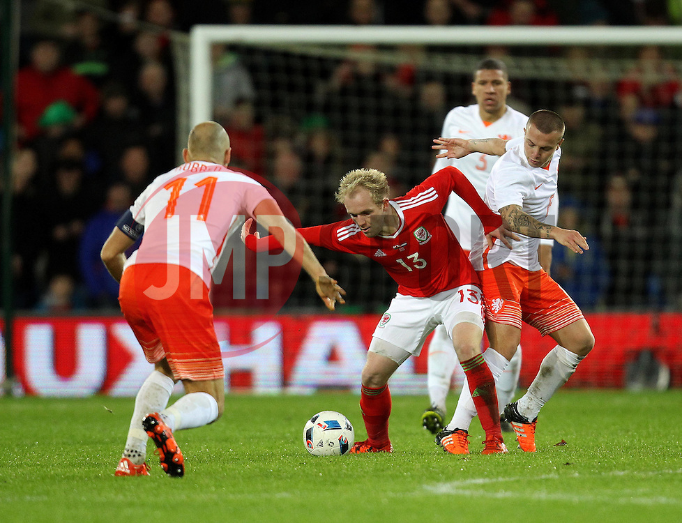 Jonathan Williams of Wales is tackled by Jordy Clasie of The Netherlands - Mandatory byline: Robbie Stephenson/JMP - 07966 386802 - 13/11/2015 - FOOTBALL - Cardiff City Stadium - Cardiff, Wales - Wales v Netherlands - International Friendly