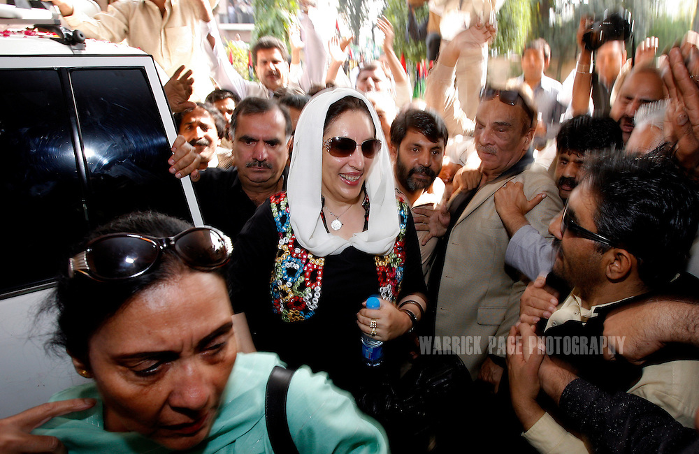 ISLAMABAD, PAKISTAN - NOVEMBER 07:  Former Pakistani Prime Minister, Benazir Bhutto, arrives at the Pakistan People's Party headquarters to attend a meeting with fellow members of the Alliance to Restore Democracy (ARD) to discuss the current crisis in Pakistan on November 7, 2007 in Islamabad, Pakistan.  Bhutto arrived in Islamabad last night to begin talks with the ARD to discuss plans on how to overturn President Musharraf's declaration of emergency rule. The president declared emergency rule on Saturday, just days before the Supreme Court was to decide on the legitimacy of Musharraf's presidency. (Photo by Warrick Page)
