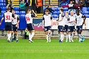 Bolton Wanderers midfielder Dennis Politic celebrates his goal with team-mates to make it 1-0 for Bolton Wanderers during the EFL Trophy match between Bolton Wanderers and Bradford City at the University of  Bolton Stadium, Bolton, England on 3 September 2019.