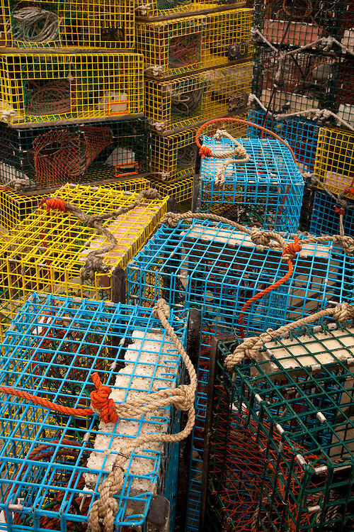 colorful, intimate composition of lobster traps and buoys found on a fishing pier in Bernard, Maine