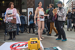 "Self proclaimed ""crazy vegan"" Heidi Mary Porter proteststs semi-naked outside London's up-market Harrods department store, which still sells fur trade products. Many furs are taken from animals using extremely cruel methods while the animals are still alive."