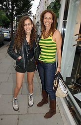 Left to right, ALICE DELLAL and her mother ANDREA DELLAL at an exhibition of rock photographer Mick Rock's exclusive 'the One and Only' photographic prints held at Notting Hill's newly opened boutique 'One' 30 Ledbury Street, London W11 on 22nd June 2006.<br />