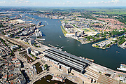 Nederland, Noord-Holland, Amsterdam, 01-08-2016; Amsterdam CS centraal station inclusief nieuwe overkapping van busstation. Overzicht IJ en IJ_oevers, de wijk Overhoeks met A'dam Tower.<br /> Amsterdam CS central station, overview of IJ and borders IJ, the district Overhoeks with Amsterdam Tower.<br /> luchtfoto (toeslag op standard tarieven);<br /> aerial photo (additional fee required);<br /> copyright foto/photo Siebe Swart