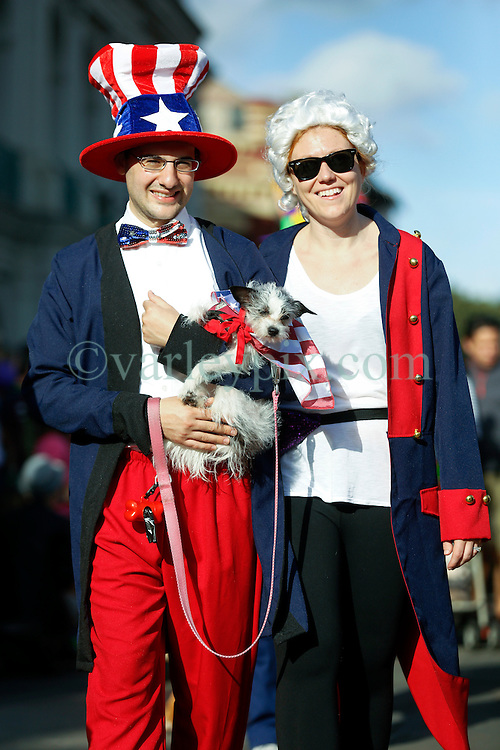31 January 2016. New Orleans, Louisiana.<br /> Mardi Gras Dog Parade. Andy Wilcox and Abby Crick with dog Smoggy. The Mystic Krewe of Barkus winds its way around the French Quarter with dogs and their owners dressed up for this year's theme, 'From the Doghouse to the Whitehouse.' <br /> Photo&copy;; Charlie Varley/varleypix.com