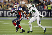Buffalo Bills running back Fred Jackson (22) catches a first quarter pass while covered by New York Jets cornerback Darrelle Revis (24) during the NFL football game against the New York Jets on December 3, 2009 in Toronto, Canada. The Jets won the game 19-13. ©Paul Anthony Spinelli