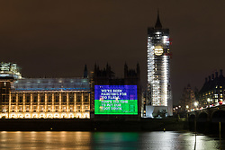 "© Licensed to London News Pictures. 06/02/2018. London, UK. A projection reading ""We've been marching for 100 years. Now's the time to put our foot down"" onto the Palace of Westminster by the Women's Equality Party to mark the centenary of the 1918 Representation of the People Act, which passed on 6 February 1918. Photo credit: Vickie Flores/LNP"