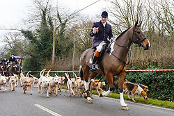 © Licensed to London News Pictures. 26/12/2018. London, UK.  The traditional Chiddingfold, Leconfield and Cowdray Boxing Day Hunt sets off from the kennels at Petworth House in Petworth Park, West Sussex.  Photo credit: Vickie Flores/LNP