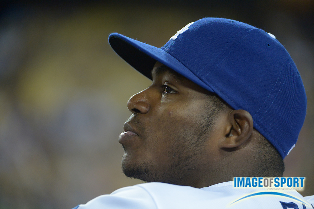 Apr 6, 2014; Los Angeles, CA, USA; Los Angeles Dodgers right fielder Yasiel Puig (66) watches from the dugout during the game against the San Francisco Giants at Dodger Stadium. The Dodgers defeated the Giants 6-2.