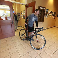 Tupelo Police Officer Bruce Dodson rolls his bicycle to the elevator at Tupelo City Hall to announce he is riding in this year's law enforcement bike ride in Washington D.C in memory of Tupelo Police Sgt. Gale Stauffer.