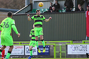 Forest Green Rovers Gavin Gunning(16) heads the ball clear during the EFL Sky Bet League 2 match between Forest Green Rovers and Crewe Alexandra at the New Lawn, Forest Green, United Kingdom on 22 December 2018.