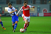 Walsall FC defender Andy Taylor chases down Fleetwood Town Midfielder Jimmy Ryan during the Sky Bet League 1 match between Fleetwood Town and Walsall at the Highbury Stadium, Fleetwood, England on 15 March 2016. Photo by Pete Burns.