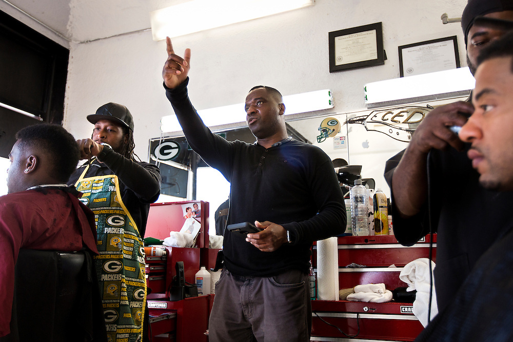 MILWAUKEE, WI - NOVEMBER 17: Justin Babar, center, talks about school segregation in the Milwaukee area on Thursday, November 17, 2016 at Upper Cutz barbershop.