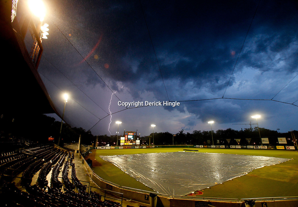 June 05, 2011; Tallahassee, FL, USA; Lightning strikes near the stadium during a suspension of play due to severe weather during the Tallahassee regional of the 2011 NCAA baseball tournament between the Florida State Seminoles and the Alabama Crimson Tide at Dick Howser Stadium. Mandatory Credit: Derick E. Hingle