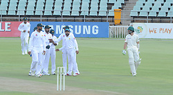 Johannesburg 19-12-18. South Africa Invitation XI vs Pakistan. Pakistan open their tour of South Africa with a three-day match at Sahara Willowmoore Park, Benoni. Day 1, afternoon session.  Joshua Richards walks past the Pakistan team after they took the wicket of Matthew Breezke<br /> Picture: Karen Sandison/African News Agency(ANA)
