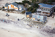 House pushed off its foundation by wave action atop of high tide caused by Hurricane Sandy.