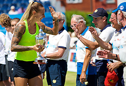 LIVERPOOL, ENGLAND - Sunday, June 18, 2017: Ladies' Champion Polona Hercog (SLO) high-fives the line judges as she parades the trophy after beating Corinna Dentoni (ITA) 6-2, 6-4 during Day Four of the Liverpool Hope University International Tennis Tournament 2017 at the Liverpool Cricket Club. (Pic by David Rawcliffe/Propaganda)