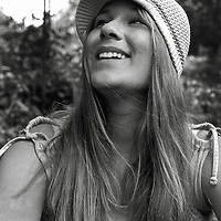 A smiling young woman wearing a knitted hat